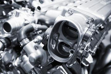 Shiny motor parts, V12 engine, closeup photo