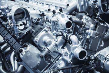 Shiny motor details, V12 car engine fragment