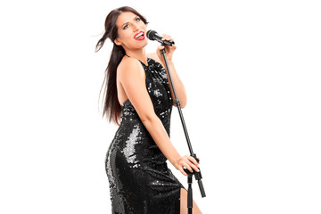 Female singer singing on a microphone