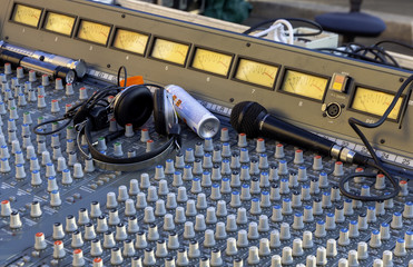 Microphones placed on a mixer during the preparation of a musical show in the square
