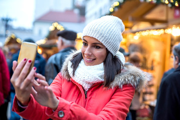 Young woman on the christmas market