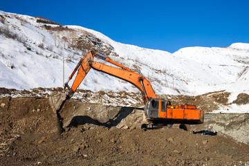 Excavator at mining