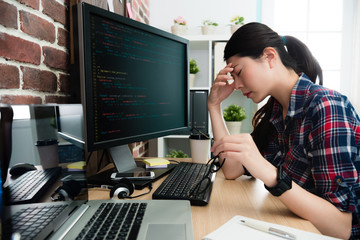 programmer looking at computer working long time