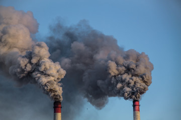 industrial chimneys with heavy smoke causing pollution