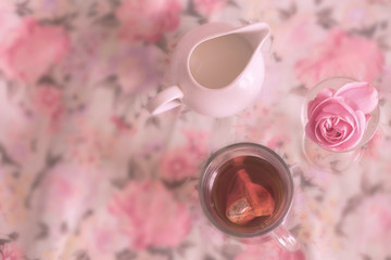 Cup of tea on Floral Summer background