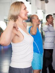 elderly exercise in modern gym