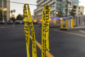 Yellow Police Line On A Downtown Street