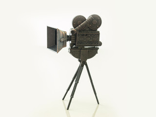 Movie film Camera toy model  / Isolated white