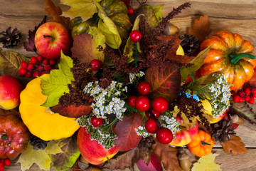 Fall arrangement with white flowers, red berries andl leaves