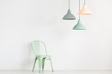 Pastel lamps above mint chair