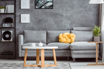 Gray room with yellow accent