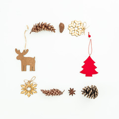 Christmas frame of decoration and pine cones on white. Flat lay, top view. New Year frame concept
