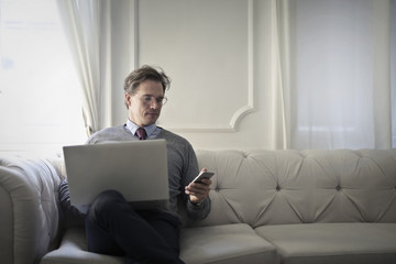 Businessman checking his devices