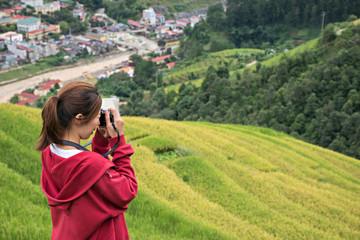 Female adventure backpack traveler in Sapa, Vietnam