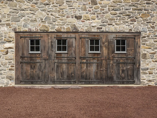 Four Wooden Doors in an Old Stone Wall