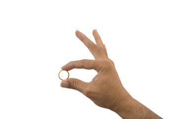 Closeup hand holding gold ring isolated on white background