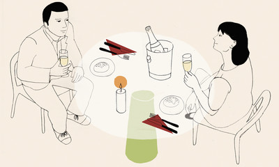 Couple drinking champagne at dining table