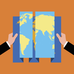 Businessman holding foldable world map