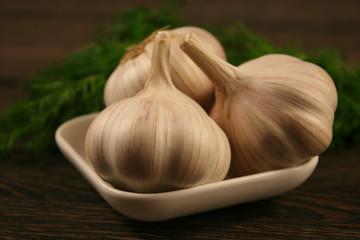 Garlic closeup on wooden background