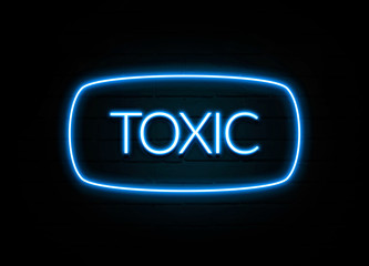 Toxic  - colorful Neon Sign on brickwall
