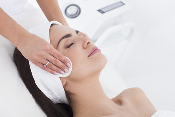 Young woman in beautician having a facial cleaning.