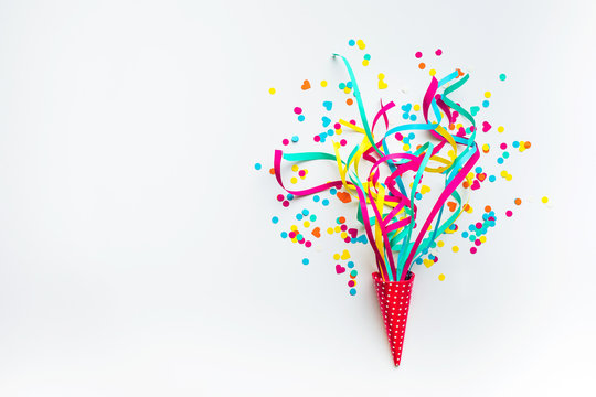 Celebration,party backgrounds concepts ideas with colorful confetti,streamers on white.Flat lay