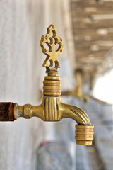Turkish Ottoman style antique ablution tap with blurred background, Istanbul, Turkey
