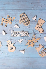 "Christmas wooden with hanging toys and ""Merry Xmas"" greeting text written with small letters"