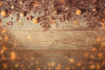 Christmas golden decoration on wooden background, close-up, top view, flat lay