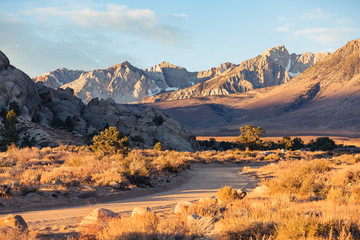 Early morning sunrise in fall hits the mountains of the eastern Sierra Nevada near Bishop, California