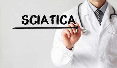 Doctor writing word Sciatica with marker, Medical concept