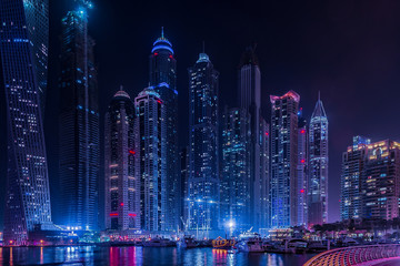 Skyscrapers on the Dubai Marina at night in Dubai, UAE