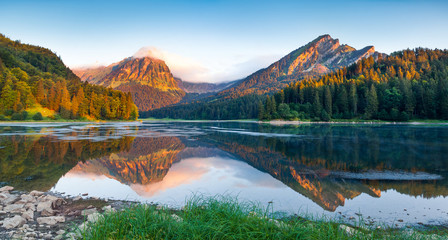 Great summer panorama of the Obersee lake.