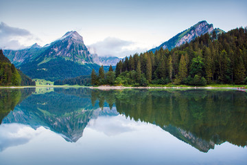 Misty summer landscape on the Obersee lake. C