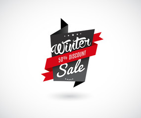 Winter sale label with red ribbon.