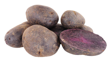 Group of raw purple majesty potatoes isolated on a white background