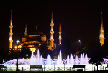 Sultanahmet Mosque with fountain in foreground at night. Istanbul, Turkey.