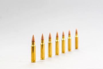 Rifle bullets. Brass Sleeve. On a white background