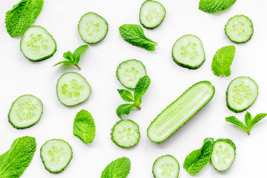 Skin care at home. Sliced cucumber pattern on white background top view