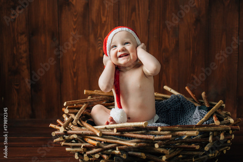 98d4262d493 Cute smiling infant baby girl in christmas hat. Happy new year concept