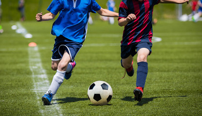 Children Kicking Soccer Match on Grass. Youth Football Game. Boys Sport Competition. Kids Playing Outdoor