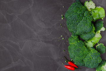 Fresh broccoli on dark wooden table background. top view