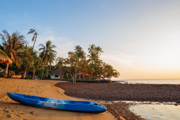 Kayak on the shore of a tropical beach on the island