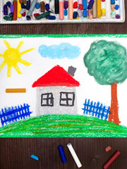Colorful drawing: House with red roof on the hill