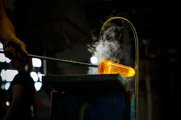 Glass blower forming piece of glass, water cooling