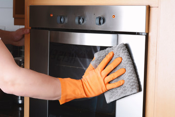 Housekeeping cleaning oven at home kitchen
