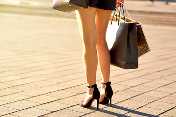 Picture of shopping bags in a young woman hands