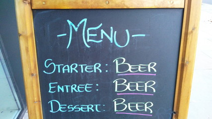 Funny beer menu on a chalkboard