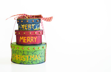 stack of 3 Christmas gift boxes tied with a plaid ribbon isolated on white