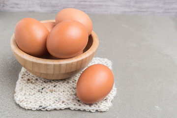 Eggs. Chicken eggs in the package on a cement background. Chicken eggs in a wodden bowl